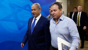 Israel's Prime Minister Benjamin Netanyahu, left, arrives to the weekly cabinet meeting in Jerusalem, on Sunday, Sept. 4, 2016. (Ronen Zvulun Pool via AP)