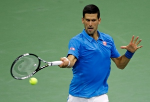 Novak Djokovic hits a return shot to Kyle Edmund during the fourth round of the U.S. Open tennis tournament, Sunday, Sept. 4, 2016, in New York. (AP / Adam Hunger)