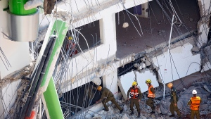 Israeli soldiers from the Home Front Command unit inspect the site of a collapsed multilevel underground parking in Tel Aviv, Monday, Sept. 5, 2016. (AP / Oded Balilty)