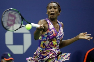 Venus Williams returns a shot to Laura Siegemund during the U.S. Open tennis tournament, Saturday, Sept. 3, 2016, in New York. (AP / Julio Cortez)