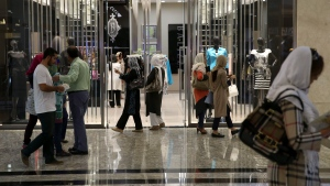 Iranians walk through the Palladium shopping center in northern Tehran, Iran, on Saturday, July 18, 2015. (AP Photo/Vahid Salemi)