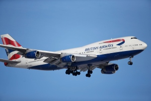In this Feb. 8, 2016 file photo, a British Airways plane lands on a runway at Denver International Airport. British Airways has apologized for delays caused by computer glitches in check-in systems — and warned that there may be further troubles. (AP Photo/David Zalubowski, File)