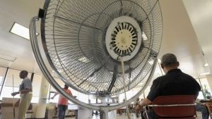 Seniors spend time near a fan at the Waxter Senior Center in Baltimore in this Thursday, June 9, 2011 file photo, after it was designated as a cooling station by Baltimore officials. Results of a study published Tuesday, Sept. 6, 2016 in the Journal of the American Medical Association suggest that in triple-digit heat, age-related changes that limit sweating might make fans less effective in those 60 and up than in younger people. But the conclusion isn't clear-cut and the study authors say more research is needed. (Steve Ruark/THE ASSOCIATED PRESS)