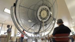 Seniors spend time near a fan a in this Thursday, June 9, 2011 file photo. (Steve Ruark/THE ASSOCIATED PRESS)