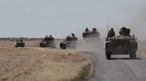 In this photo taken on Friday, Sept. 2, 2016, Turkish tanks head to the Syrian border, in Karkamis, Turkey. (Ismail Coskun, IHA via AP)