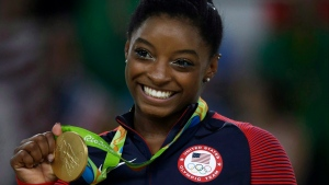 United States' Simone Biles displays her gold medal for floor during the artistic gymnastics women's apparatus final at the 2016 Summer Games in Rio de Janeiro, Brazil, Tuesday, Aug. 16, 2016. (AP Photo/Rebecca Blackwell)