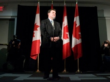 Federal Finance Minister Jim Flaherty speaks to the press after addressing a conference on world markets, in Toronto, on Friday February 6 2009. (Chris Young / THE CANADIAN PRESS)