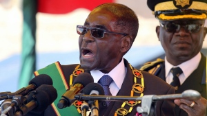 In this Monday, Aug. 8, 2016 file photo, Zimbabwean President Robert Mugabe addresses party supporters during a gathering to honor the country's dead heroes, at the National Heroes Acre in Harare. (Tsvangirayi Mukwazhi, file/AP Photo)