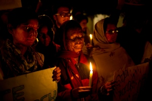 In this Dec. 16, 2014 file photo, acid attack survivors participate in a candlelit vigil protesting violence against women as they mark the second anniversary of the deadly gang rape of a student on a bus, in New Delhi, India.  (Saurabh Das/AP)