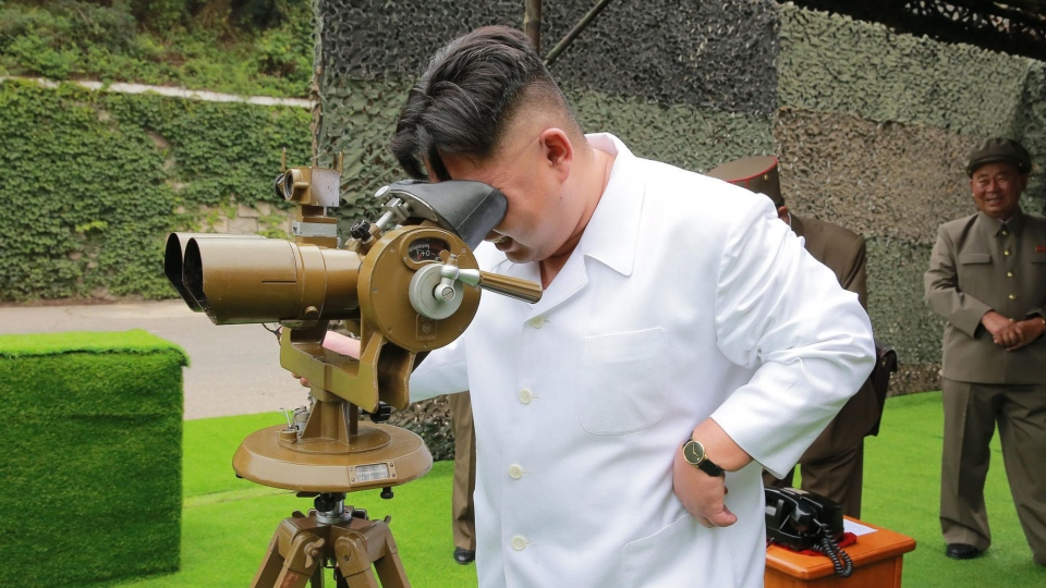 This undated photo distributed on Tuesday, Sept. 6, 2016, by the North Korean government shows North Korean leader Kim Jong Un looking though binoculars at the site of a ballistic missile launching at an undisclosed location in North Korea. (Korean Central News Agency / Korea News Service via AP)