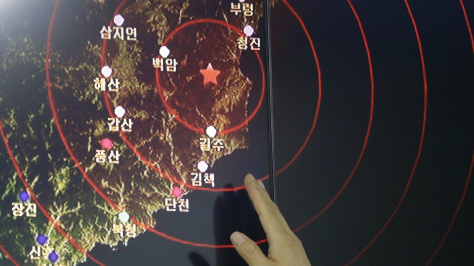 An official of the Earthquake and Volcano of the Korea Monitoring Division points at the epicenter of seismic waves in North Korea, in Seoul, South Korea on Friday, Sept. 9, 2016. (AP / Ahn Young-joon)