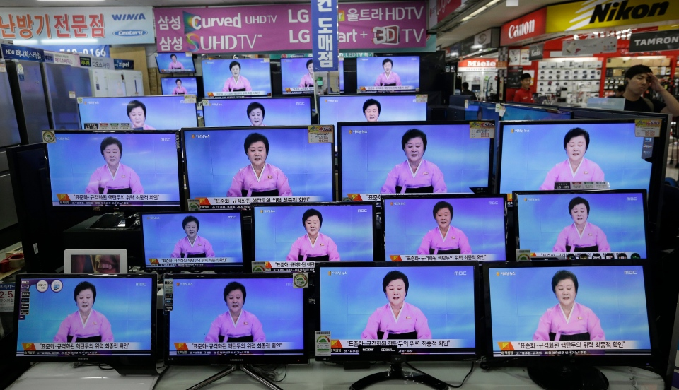TV screens show a North Korean newscaster reading a statement from the North's Nuclear Weapons Institute during a news program at the Yongsan Electronic Market in Seoul, South Korea, Friday, Sept. 9, 2016. (AP Photo/Ahn Young-joon)
