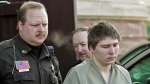 In this Friday, March 3, 2006 file photo, Brendan Dassey, 16, is escorted out of a Manitowoc County Circuit courtroom in Manitowoc, Wis. (AP Photo/Morry Gash)