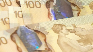 Canadian $100 dollars bills are seen in this file photo.