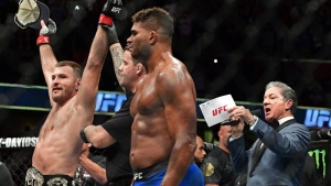 Stipe Miocic has his arm raised by the referee after defeating Alistair Overeem, from the Netherlands, during a heavyweight title bout at UFC 203 on Saturday, Sept. 10, 2016, in Cleveland. (AP /David Dermer)