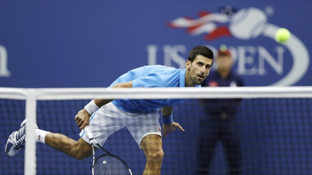 Novak Djokovic, of Serbia, returns a shot to Stan Wawrinka, of Switzerland, during the men's singles final of the U.S. Open tennis tournament, Sunday, Sept. 11, 2016, in New York. (AP / Charles Krupa)