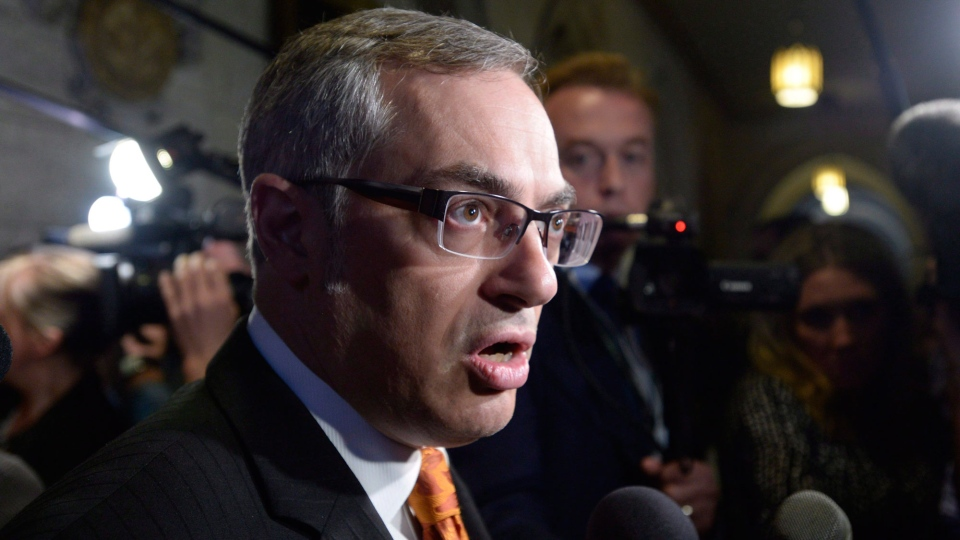 Then-treasury board president Tony Clement fields questions in the foyer outside the House of Commons in Ottawa, Monday, May 11, 2015. (Adrian Wyld / THE CANADIAN PRESS)