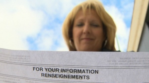 Kathy Stoyka is seen reading the final notice sent by Manitoba's provincial court, on Sept. 12, 2016. (CTV Winnipeg)