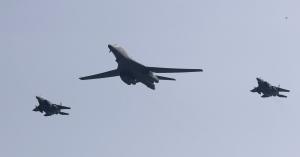 U.S. B-1 bomber, centre, flies over Osan Air Base with South Korean jets in Pyeongtaek, South Korea, Tuesday, Sept. 13, 2016. (AP / Lee Jin-man)