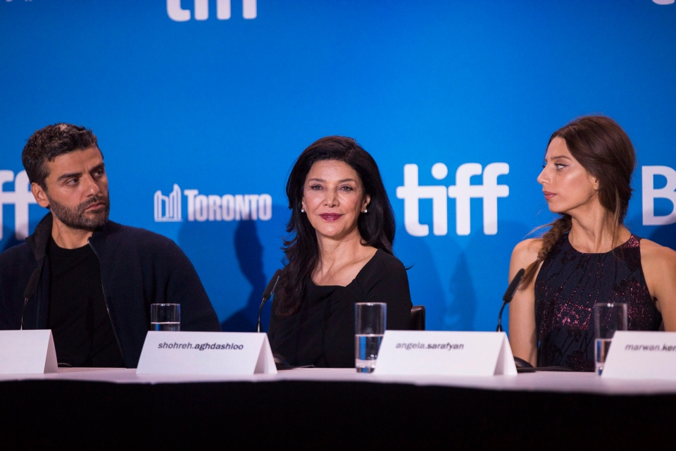 Actors Oscar Isaac, left, Shohreh Aghdashloo, centre, and Angela Sarafyan, right, attend a press conference to promote the historical drama about the Armenian genocide 'The Promise' during the Toronto International Film Festival on Monday, September 12, 2016. (THE CANADIAN PRESS/Michelle Siu)