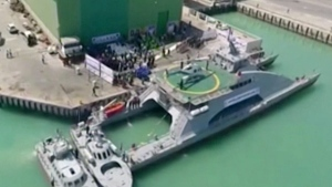 A new catamaran vessel is unveiled in the port of Bushehr, Iran, on Sept. 13, 2016. (IRINN-Iranian TV via AP)
