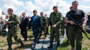 Rebel leaders Alexander Zakharchenko, second right, and Denis Pushilin, third right, near Hrabove, eastern Ukraine, on July 17, 2015. (Antoine E.R. Delaunay / AP)