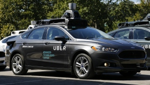 A group of self driving Uber vehicles position themselves to take journalists on rides during a media preview at Uber's Advanced Technologies Center in Pittsburgh, Monday, Sept. 12, 2016. (AP / Gene J. Puskar)