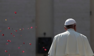 Flower petals are tossed by faithful as Pope Francis leaves at the end of his weekly general audience in St.Peter's Square at the Vatican, Wednesday, Sept. 14, 2016. (AP Photo/Alessandra Tarantino)