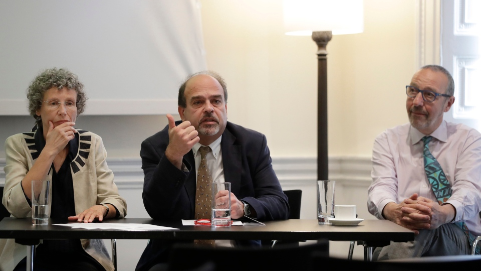In this photo taken on Monday, Sept. 12, 2016, chief investigator Professor Freddie Hamdy, centre, and co-researchers Professor Jenny Donovan, left, and Professor David Neal, right, sit during a press briefing to announce the results of the world's first and largest trial into treatment for prostate cancer, in London.