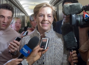 Conservative Party leadership hopeful Kellie Leitch speaks with reporters at the party's summer caucus retreat in Halifax on Sept. 13, 2016. (Andrew Vaughan / CANADIAN PRESS)
