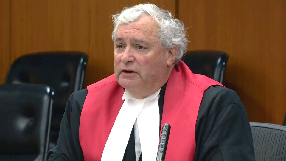 Alberta Justice Denny Thomas delivers the verdict in the Travis Vader murder trial in an Edmonton court, Thursday, Sept. 16, 2016.