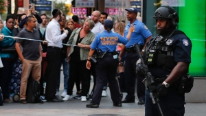 A New York Police counterterrorism officer stands watch at the corner of 32nd Street and 6th Avenue, a half block from where police say a man with a meat cleaver attacked an officer and was shot at least twice during a struggle with officers trying to subdue him in New York on Thursday, Sept. 15, 2016. (AP / Julie Jacobson)