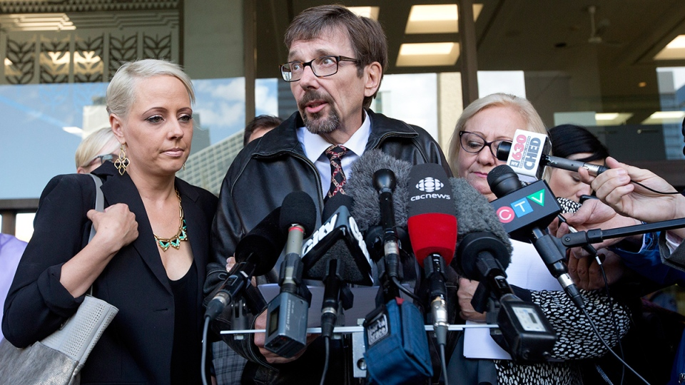 Nicole Walshe, daughter of Bret McCann, Bret McCann and his wife Mary-Ann McCann speak to media after Travis Vader was convicted of 2 counts of 2nd-degree murder of Lyle and Marie McCann in Edmonton, on Thursday, Sept. 15, 2016. (Jason Franson / THE CANADIAN PRESS)