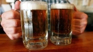 Two mugs of beer at a tavern. (AP Photo/Toby Talbot)