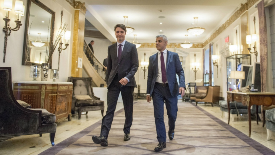 Prime Minister Justin Trudeau, left, and London Mayor Sadiq Khan walk down the hall of the Ritz hotel at the Global Progress conference in Montreal on Thursday, September 15, 2016. (Paul Chiasson / THE CANADIAN PRESS)
