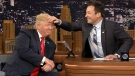 Jimmy Fallon touches Donald Trump's hair on 'The Tonight Show with Jimmy Fallon,' Thursday, Sept. 15, 2016.