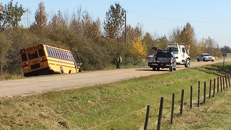 RCMP on the scene of a collision involving a car and a school bus on Twp Rd. 514 and RR 261 on Friday, September 16, 2016.