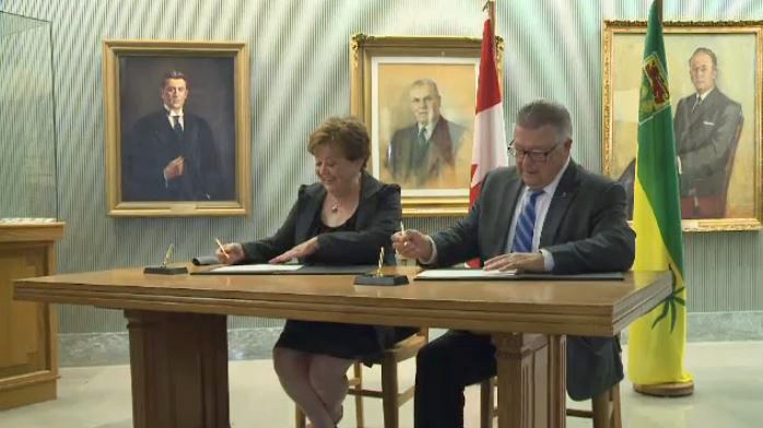 Saskatchewan Government Relations Minister Donna Harpauer and federal Public Safety Minister Ralph Goodale sign a bilateral infrastructure agreement at the provincial legislature in Regina on Friday, Sept. 16, 2016.