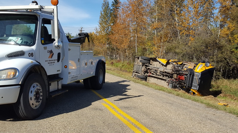 A number of students from a Parkland County school were taken to hospital Friday morning after a school bus crash. (Courtesy: CRS Towing & Recovery)