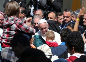 In this April 16, 2016 file photo, Pope Francis meets migrants at the Moria refugee camp on the Greek island of Lesbos. (AP / Petros Giannakouris)