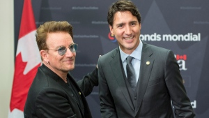 Prime Minister Justin Trudeau greets Bono prior to a meeting at the Global Fund conference Saturday, September 17, 2016 in Montreal. THE CANADIAN PRESS/Paul Chiasson