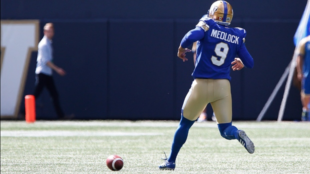 Winnipeg Blue Bombers kicker Justin Medlock (9) chases down a wild snap against the Toronto Argonauts during the first half of CFL action in Winnipeg Saturday, September 17, 2016. THE CANADIAN PRESS/John Woods