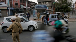 Indian policemen check vehicles in Srinagar, Indian controlled Kashmir, Sunday, Sept. 18, 2016. Suspected rebels using guns and grenades sneaked into a crucial army base in Indian-controlled Kashmir early Sunday and killed at least 17 soldiers in the deadliest attack on a military base in the disputed Himalayan region in recent years, the army said. (Mukhtar Khan/AP)