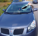 A woman and her baby were lucky to escape injury when flying debris broke through their windshield in Norfolk County on Sunday, September 18th, 2016. (photo courtesy: Norfolk County OPP)