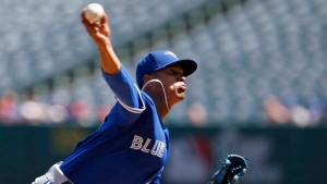 Toronto Blue Jays pitcher Marcus Stroman throws to the plate in the first inning of a baseball game against the Los Angeles Angels in Anaheim, Calif., Sunday, Sept. 18, 2016. (AP Photo/Christine Cotter)