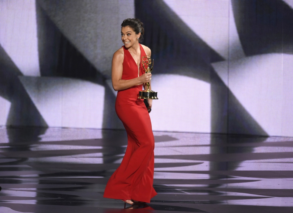 "Tatiana Maslany accepts the award for outstanding lead actress in a drama series for ""Orphan Black"" at the 68th Primetime Emmy Awards on Sunday, Sept. 18, 2016, at the Microsoft Theater in Los Angeles. (Photo by Chris Pizzello/Invision/AP)"