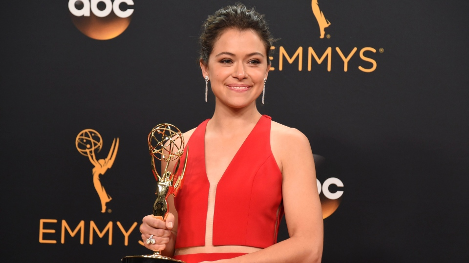"Tatiana Maslany winner of the award for outstanding lead actress in a drama series for ""Orphan Black"" poses in the press room at the 68th Primetime Emmy Awards on Sunday, Sept. 18, 2016, at the Microsoft Theater in Los Angeles. (Jordan Strauss/AP)"