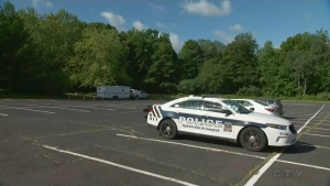 Longueuil police in the parking lot of Mont Saint Bruno park