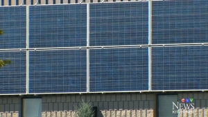 Solar panels on the side of a building in this undated file photo.