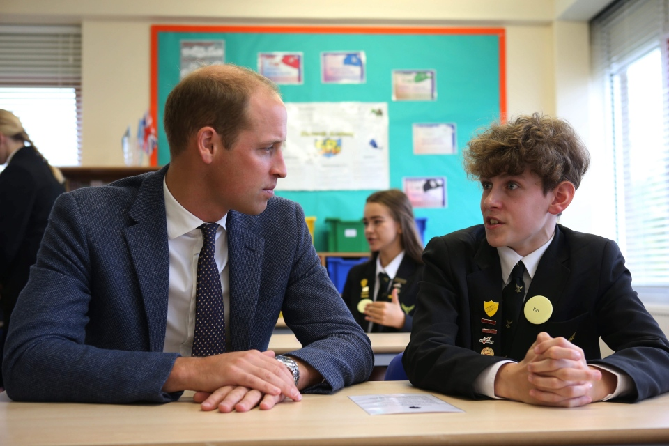 """Prince William sits in on a class, during a visit to the Stewards Academy with Kate, the Duchess of Cambridge, as part of their """"Heads Together' campaign, in Harlow, Essex, England, Friday, Sept. 16, 2016. (Ian Vogler/Pool Photo via AP)"""